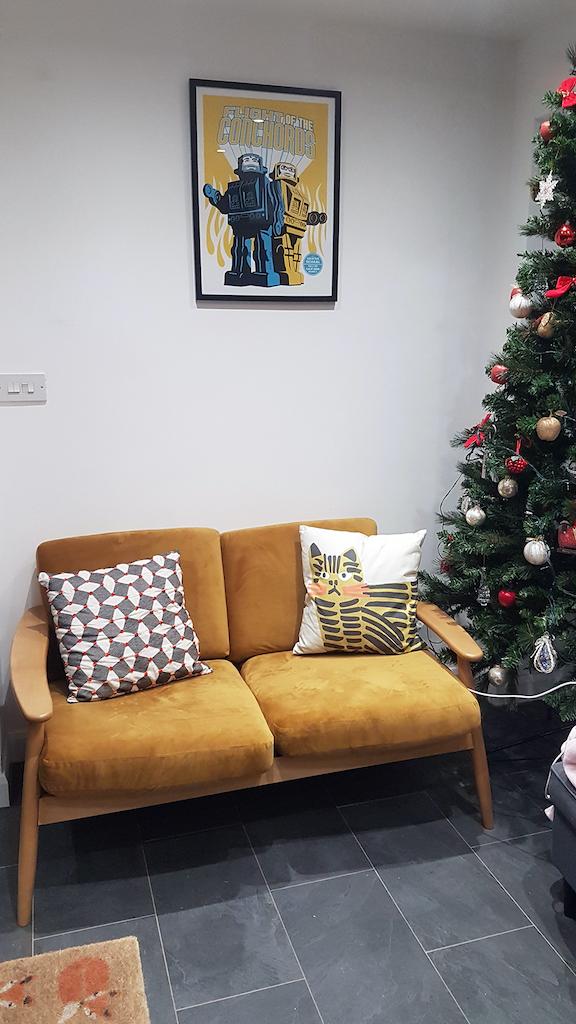 Mustard sofa on a light wooden frame - Demure