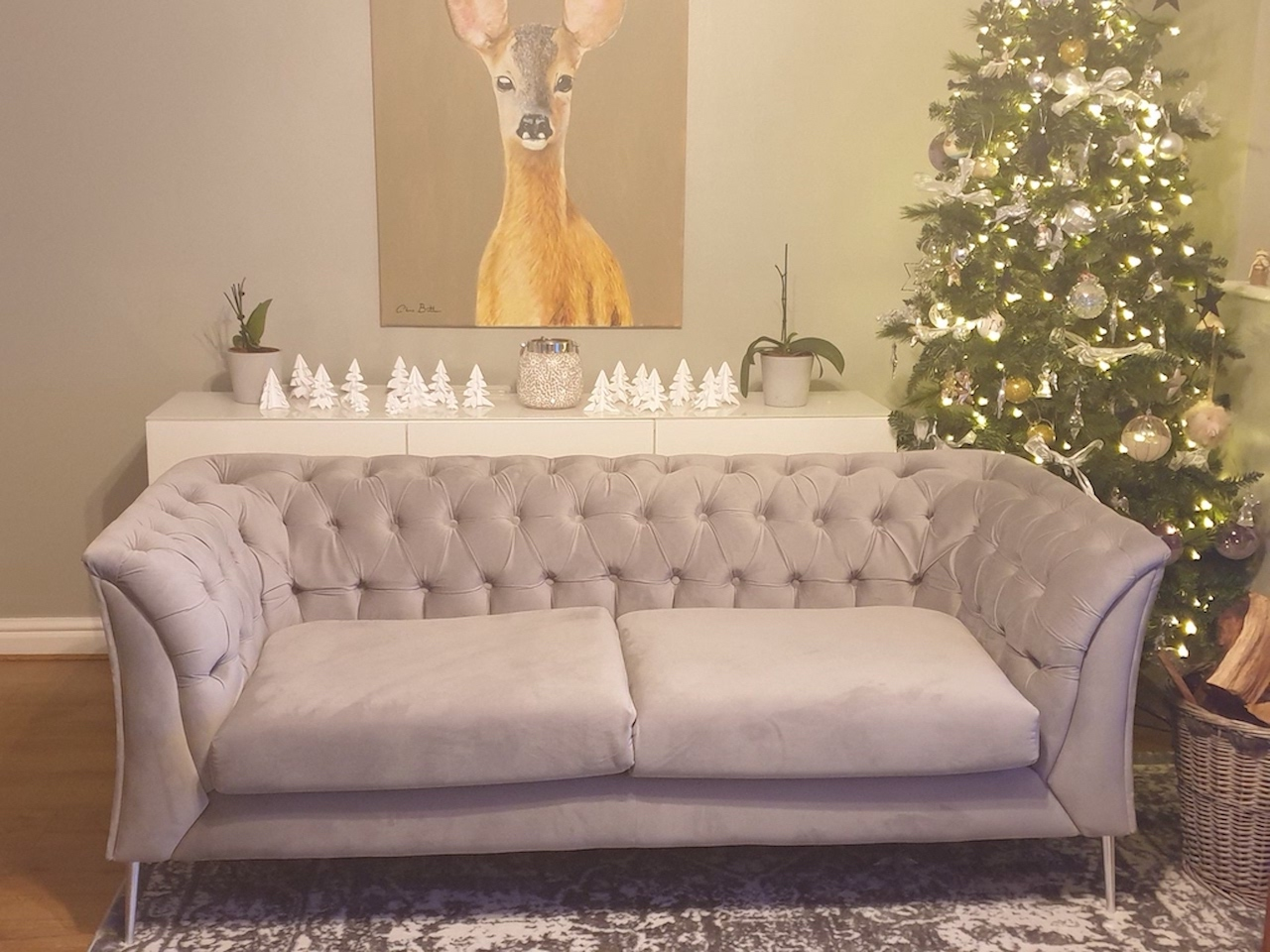 Chesterfield Modern grey sofa on silver legs, christmas decoration