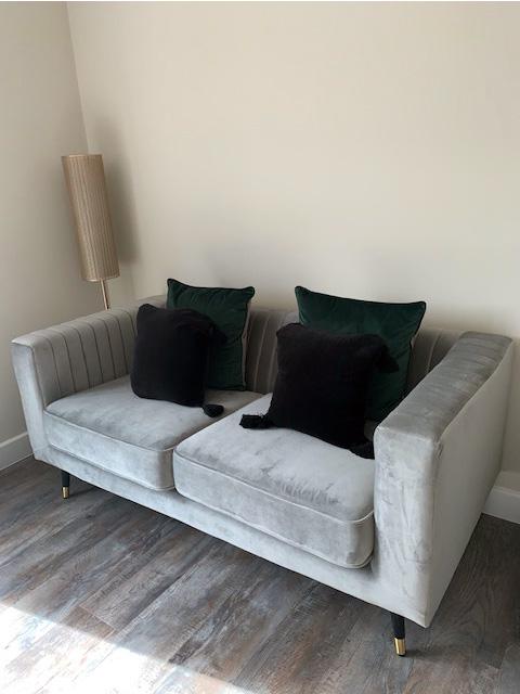 Grey Slender Sofa in Lauren Johnson's living room