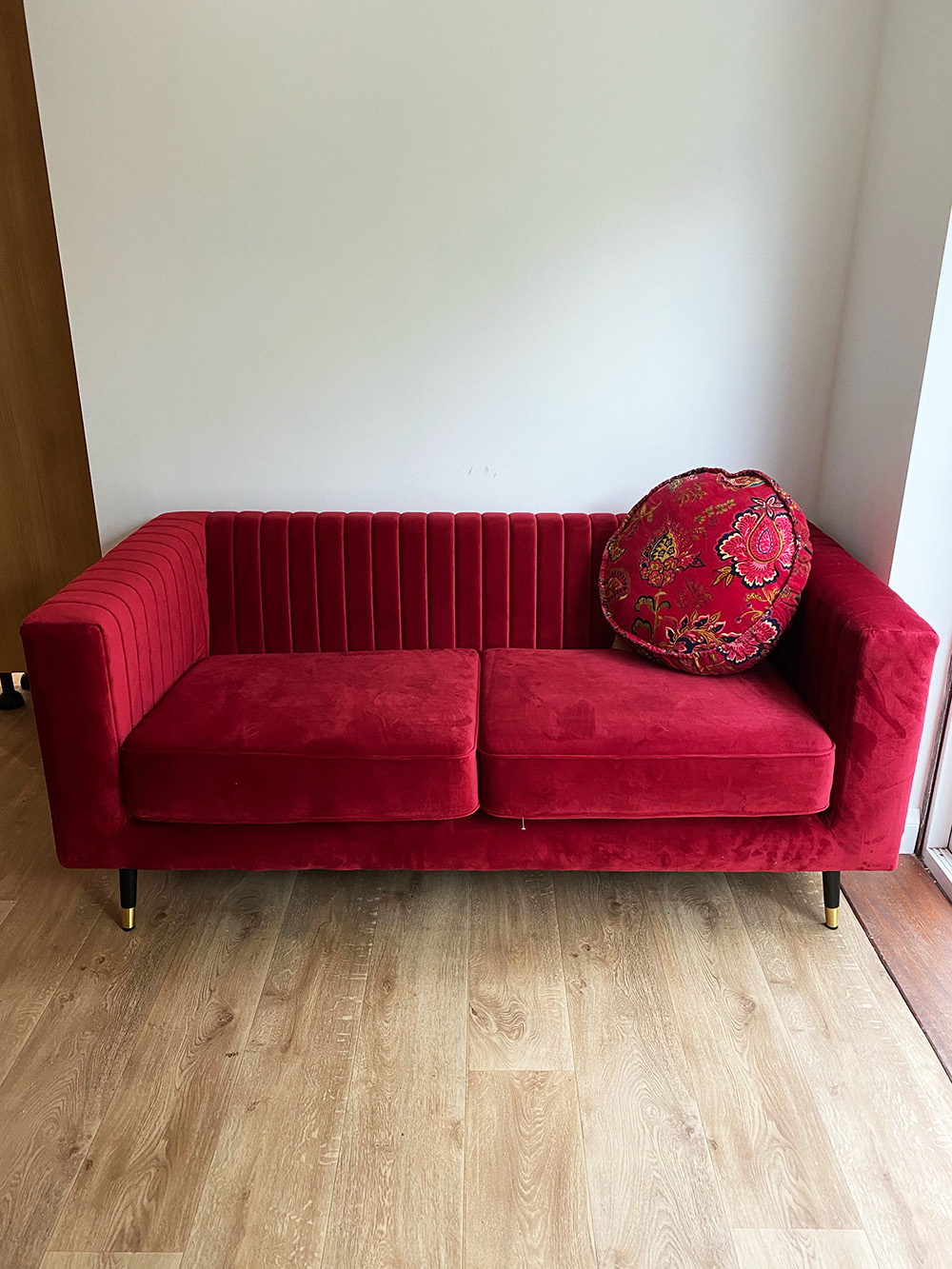 Red Slender sofa in cosy interior