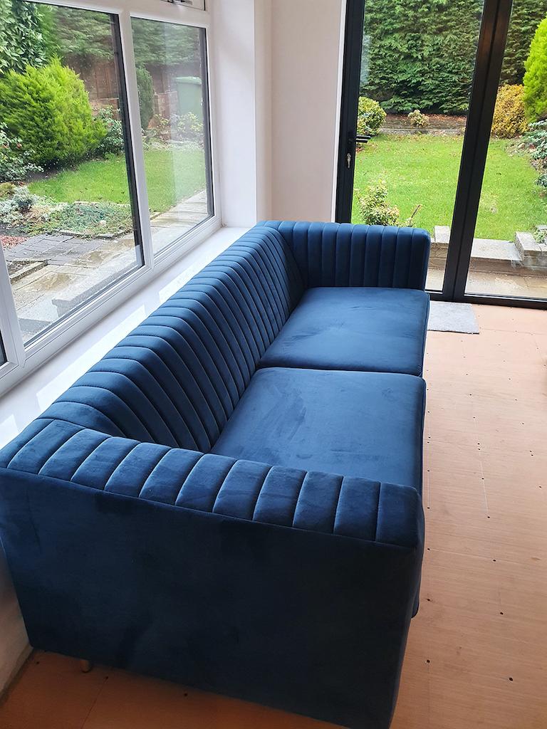 Slender blue three-seater sofa from Dana