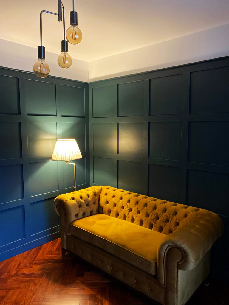 Chesterfield Grand double mustard sofa in a retro room