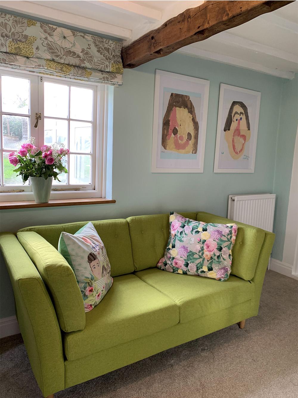 Green sofa Viko with additional decorative cushions