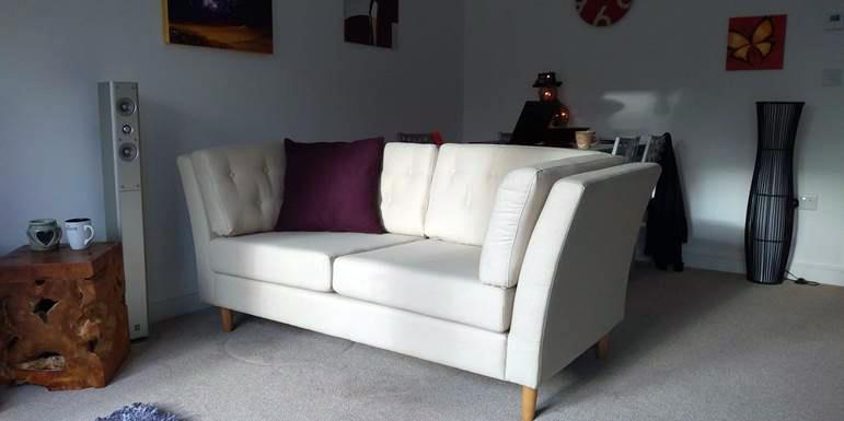 Viko - cream-coloured two-seater sofa in Scandinavian style
