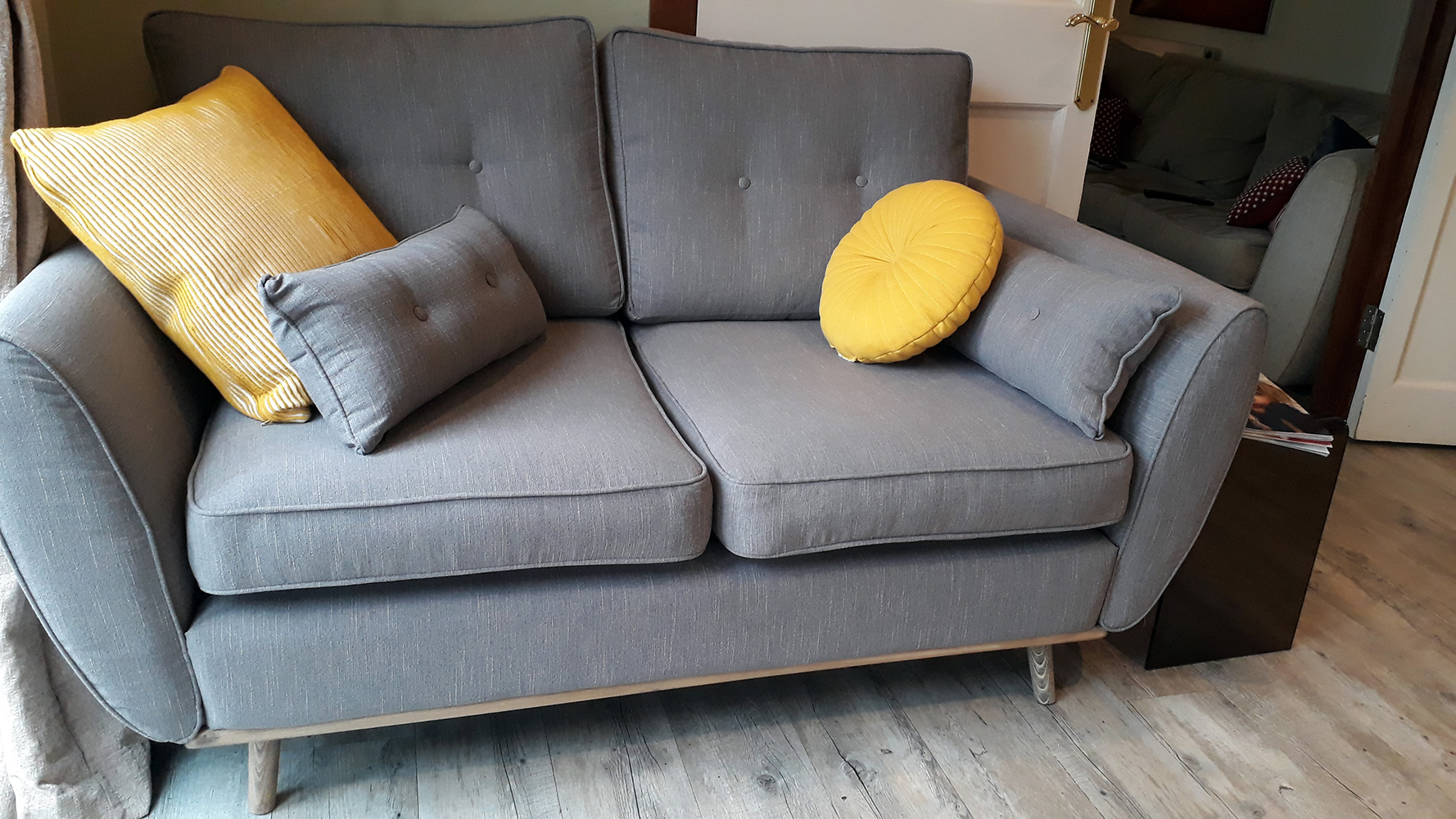 Small grey Zinola sofa with light wooden legs