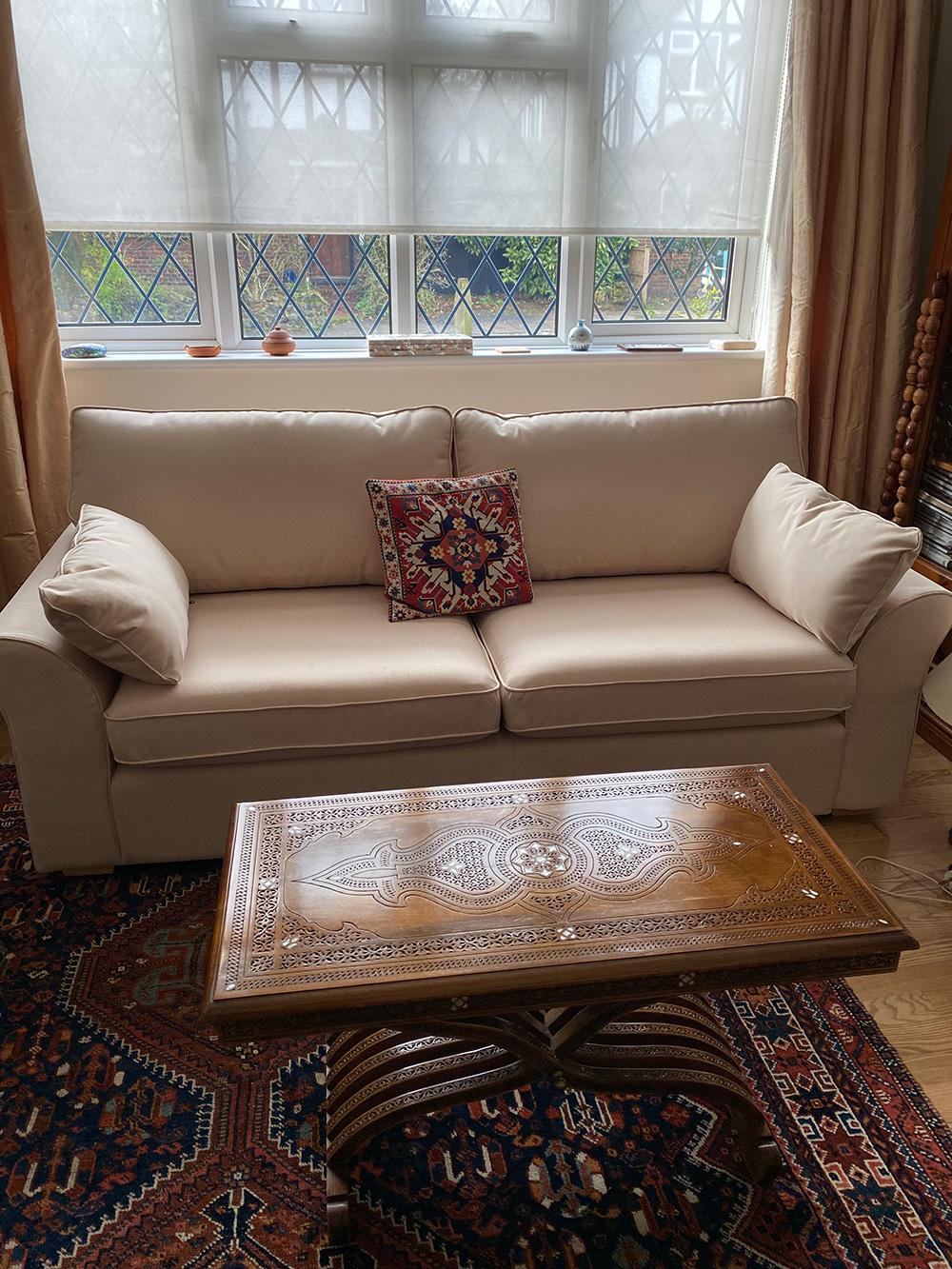 Cream three-seater sofa Icon