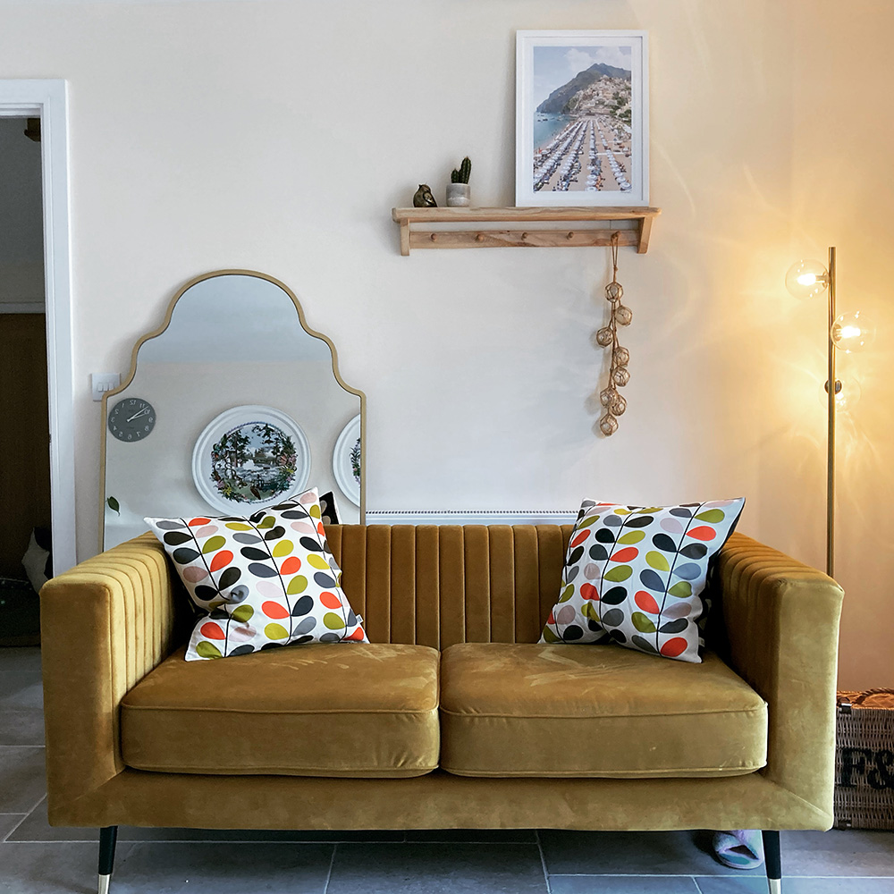 Mustard sofa in the room with gold accessories