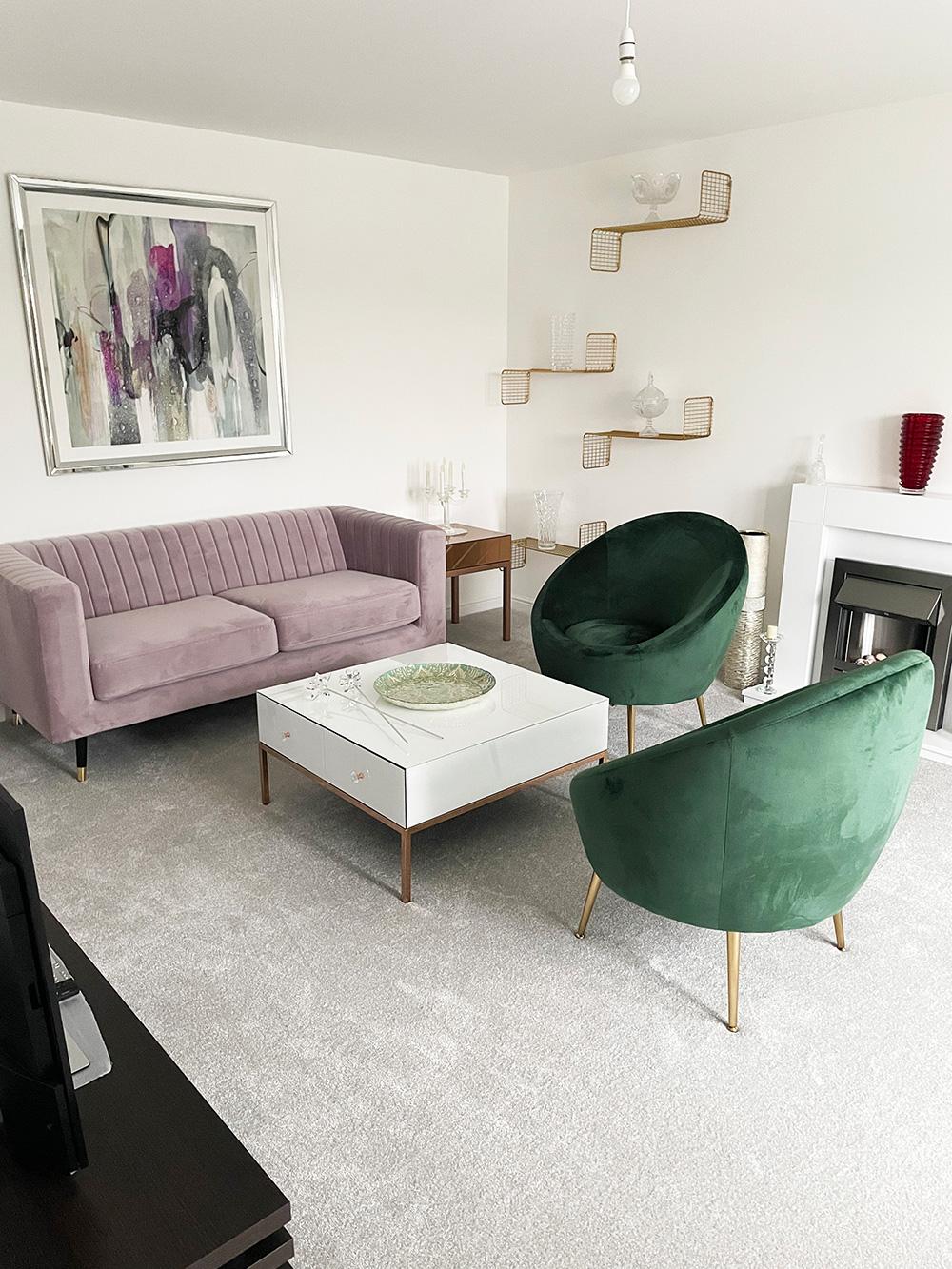 Slender sofa in powder pink in modern living room