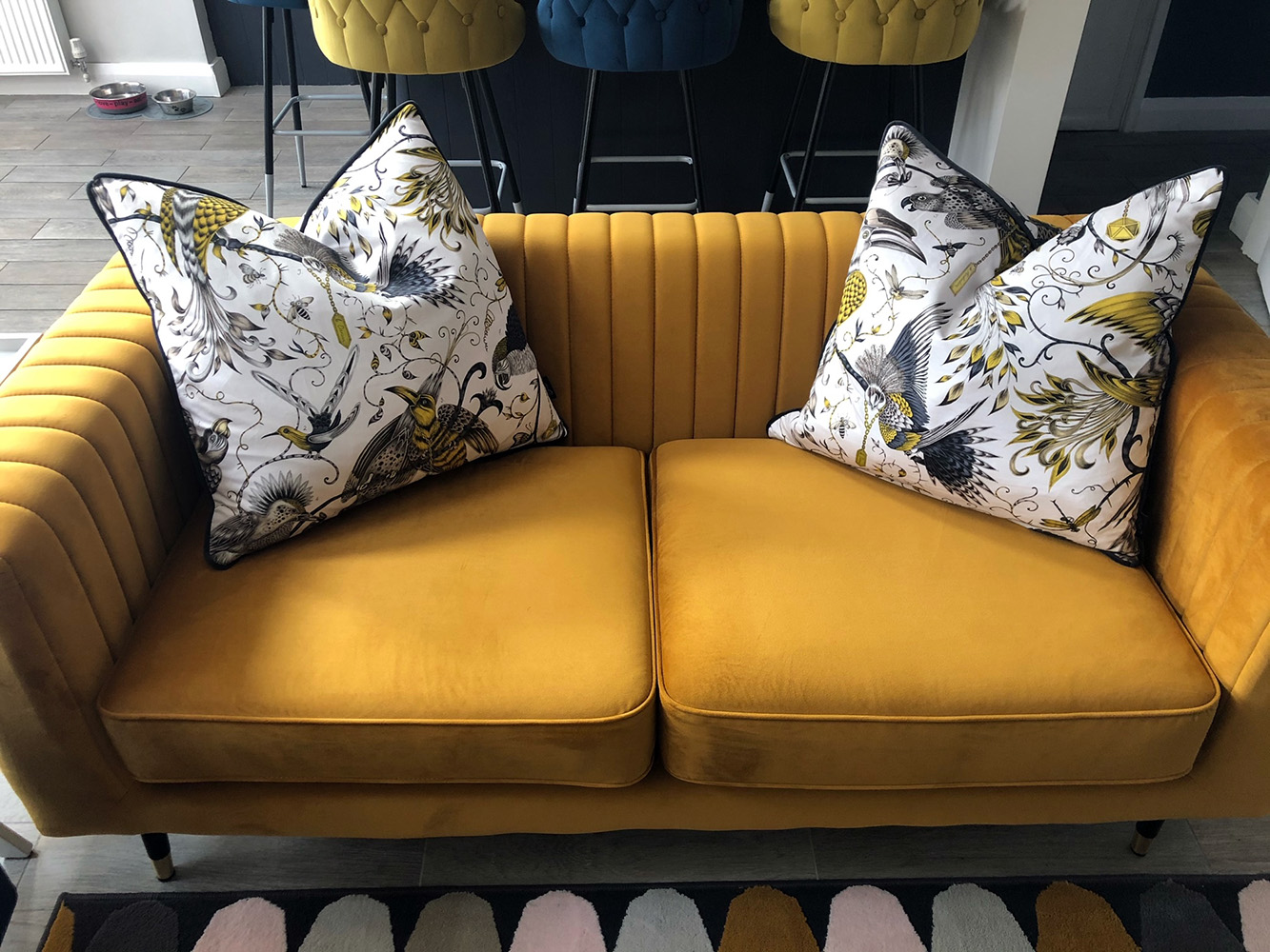 Navy blue armchair and yellow Slender sofa