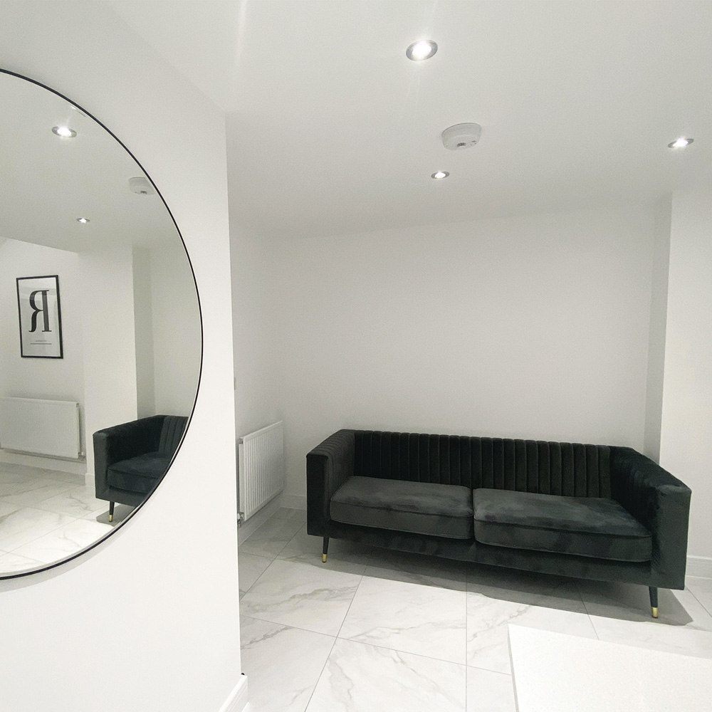 Slender grey sofa in an elegant minimalist living room