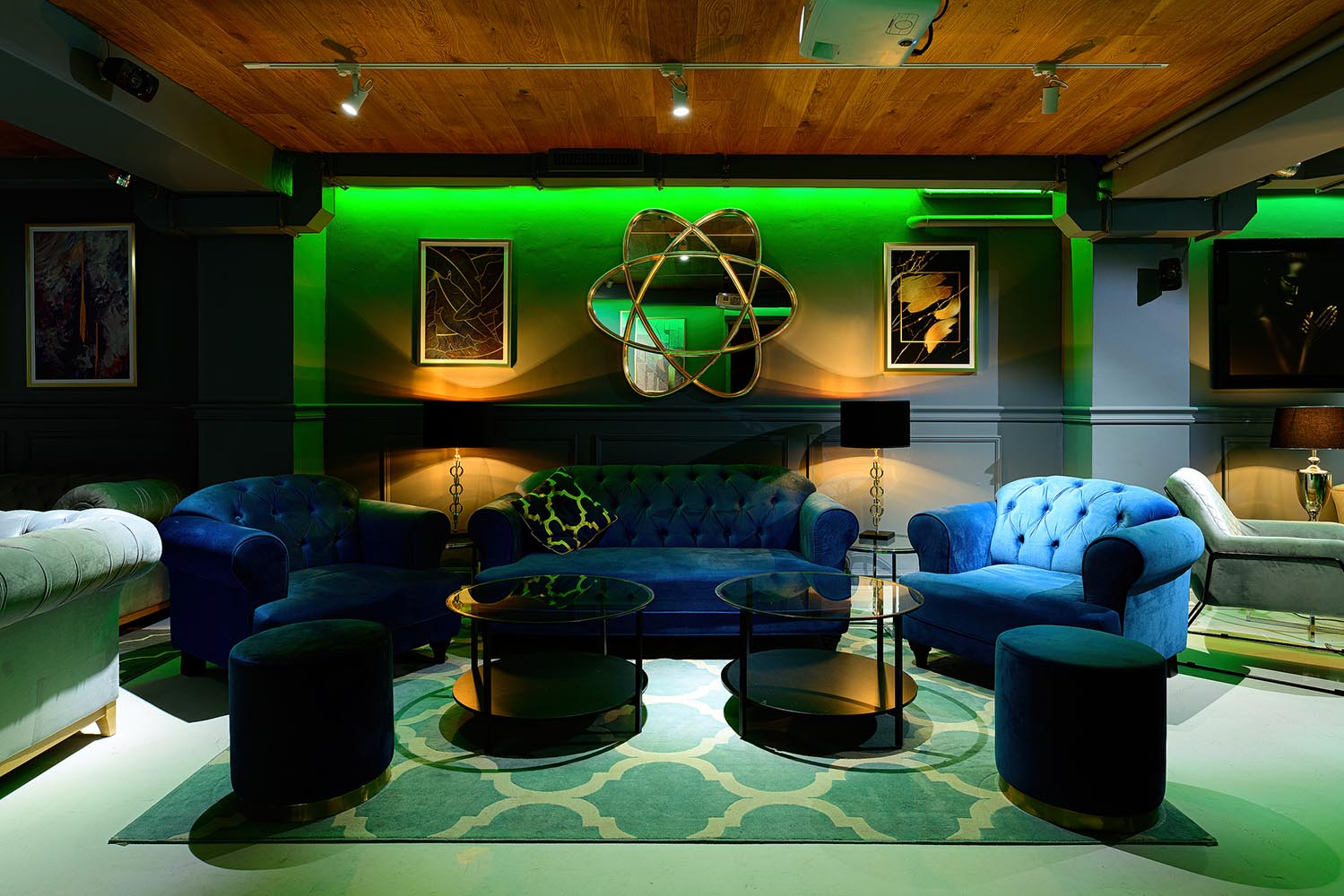 Dark blue sofa and Harto armchairs