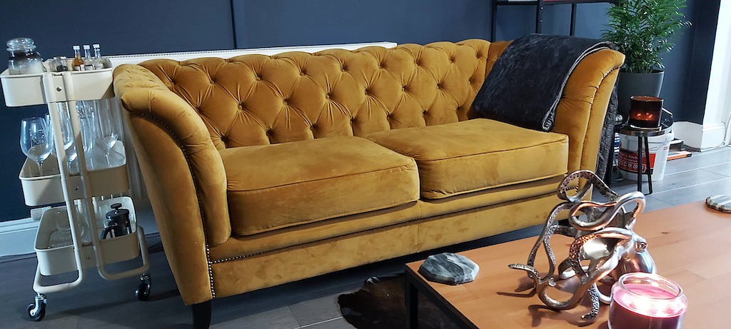 Karin - yellow chesterfield-style sofa on black legs