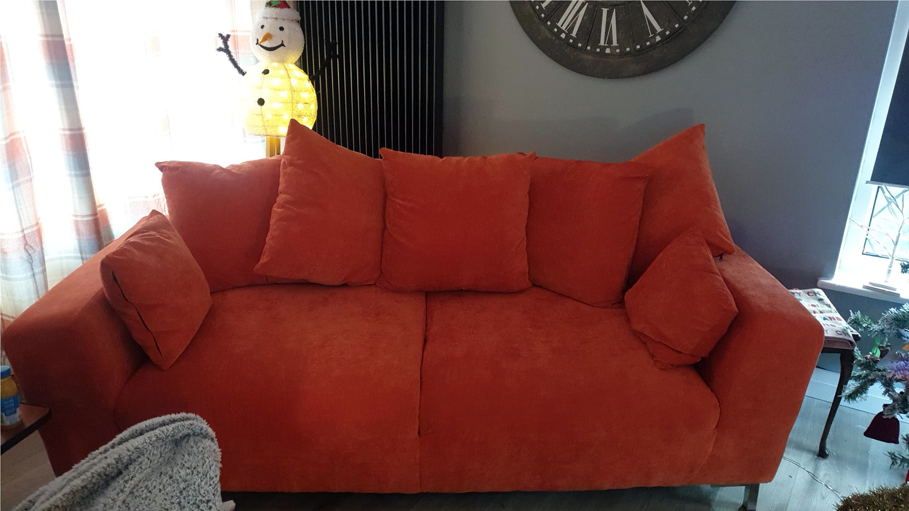 Orange Stone sofa on metal legs