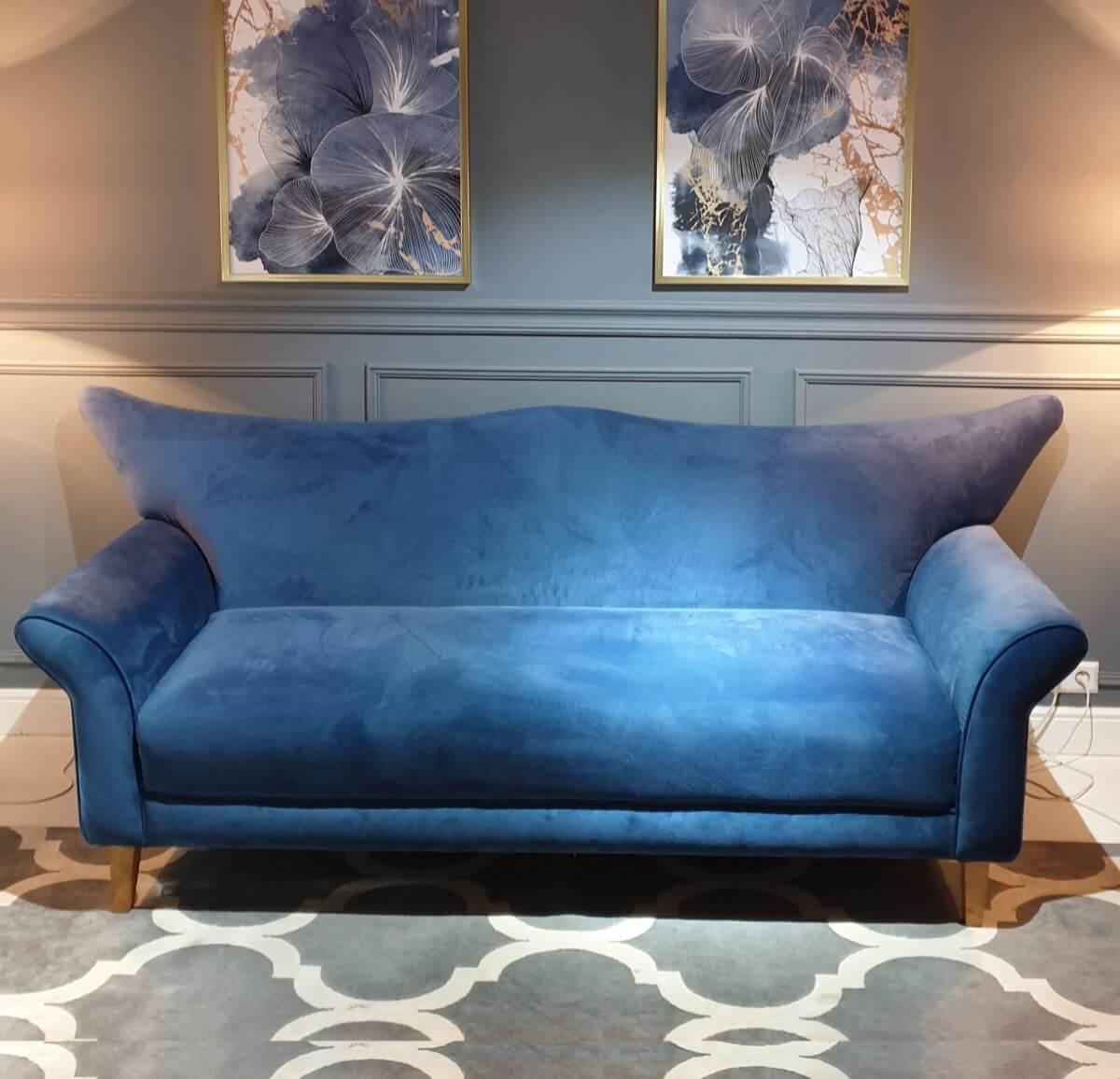 Camelback sofa in blue fabric