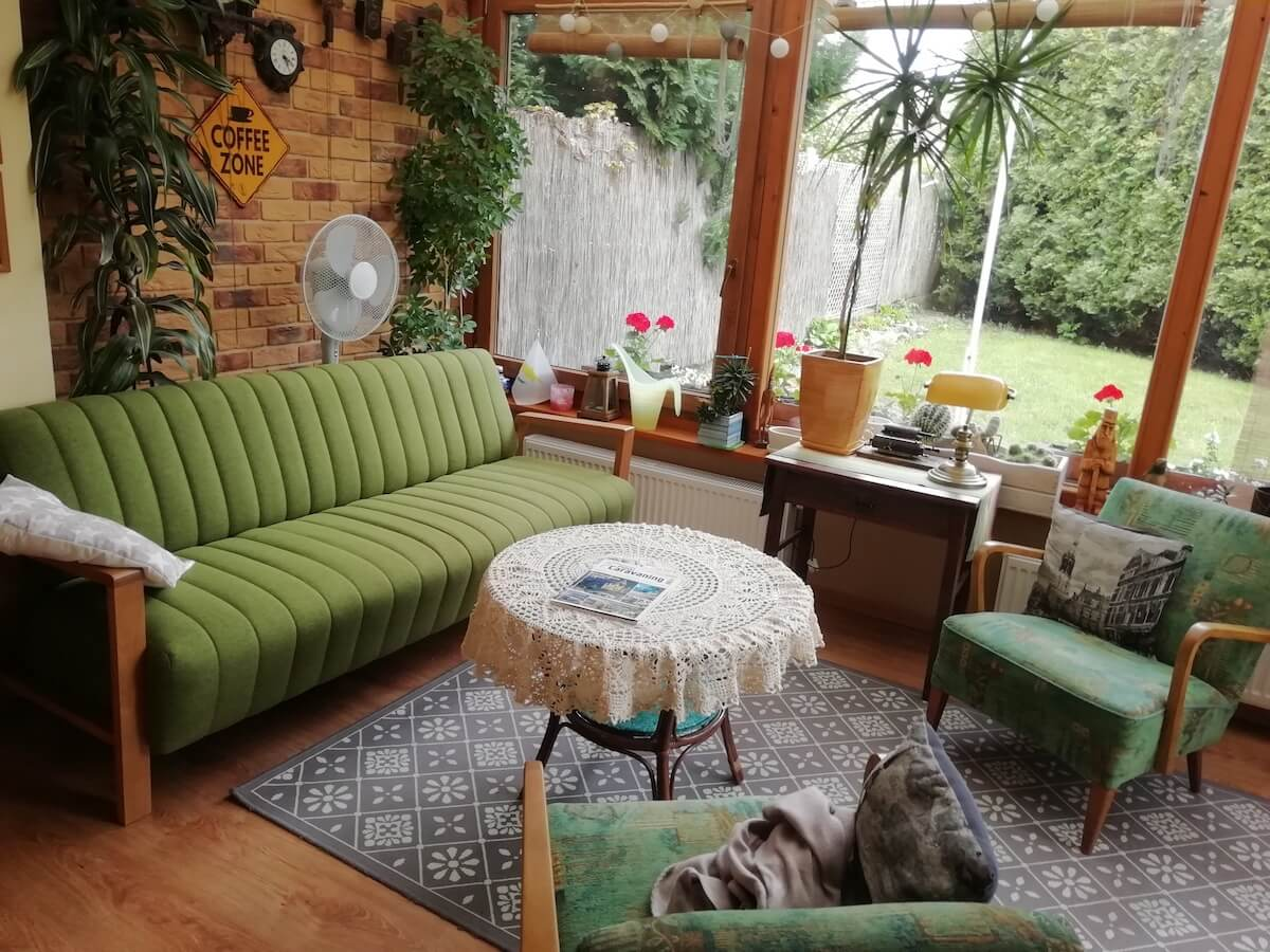 Green fabric sofa in winter garden