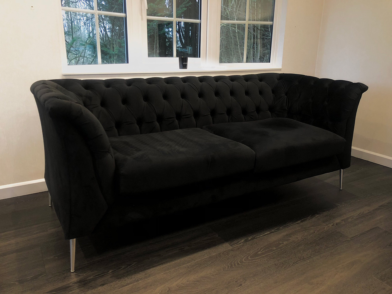Black Chestefield Modern sofa from Chanel